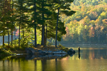 Fisherman in early morning, Lac Taylor, Gatineau National Park, Quebec, Canada