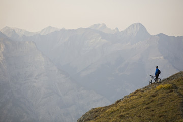 A mountain biker reflects on the beauty of Kananaskis country, Canadian Rockies, AB