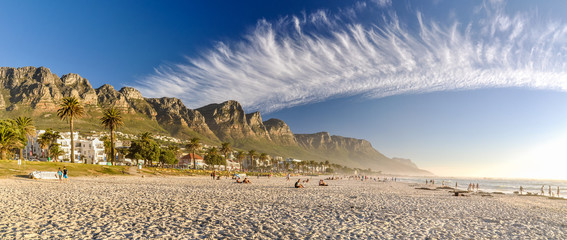 Stunning XXL panorama of Camps Bay, an affluent suburb of Cape Town, Western Cape, South Africa. With its white beach, Camps Bay attracts a large number of foreign visitors as well as South Africans.