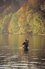 Man fly fishing in autumn, Cherry Point, Vancouver Island, British Columbia, Canada.