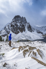Hiker at the Nublet, with Sunburst Peak in the background, Mount Assiniboine Provincial Park, British Columbia, Canada