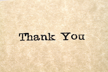 "A close up image of the words ""Thank You"" from a typewriter"