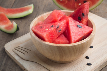 Kitchen table with Sliced of watermelon.