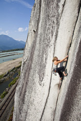 A strong female climber climbing Crescent Crack 10d, Squamish, BC