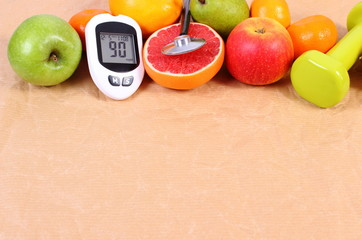 Glucometer, stethoscope and fresh fruits with dumbbells, diabetes, healthy lifestyles