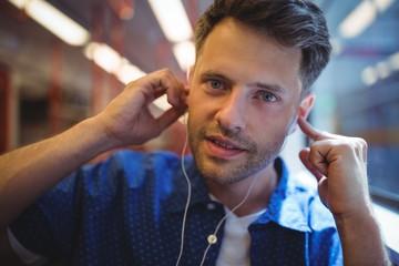 Portrait of handsome man listening music