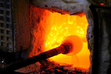 glass melting in a traditional oven of a glassblower manufacture