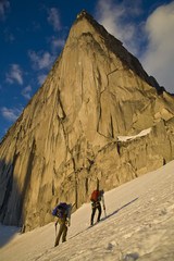 Two female climbers hike towards Bugaboo/Snowpatch Col in Bugaboo Provincial Park, BC.