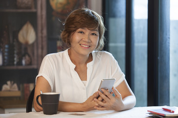 asian woman with smiling face happiness emotion and mobile phone