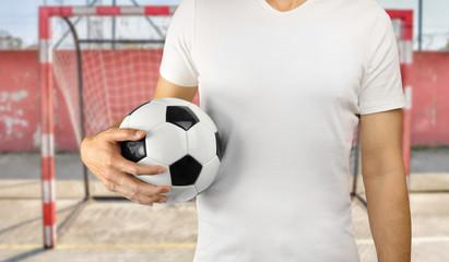 sportman holding a soccer ball