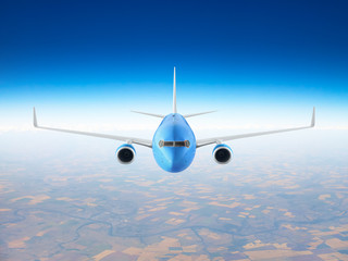 Wall Mural - Passenger airplane flying over the earth
