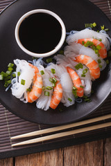 Shirataki Noodles with shrimp and green onions close-up. vertical top view