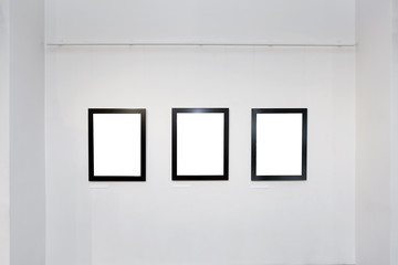 exhibition gallery interior with empty frames on wall