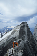 Man rock climbing on Pigeon Spire west ridge, Bugaboos, British Columbia, Canada.