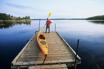 Kayak on boat dock, Nutimik Lake campground,Whiteshell Provincial Park, Manitoba, Canada.