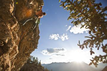 A man rock climbs the sport route Peyto Powder 12a, Echo Canyon, Canmore, Alberta, Canada