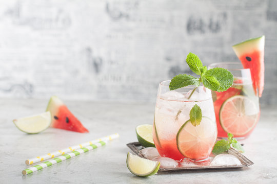 Fresh watermelon lemonade with lime, ice and mint for the summer party on the metal tray
