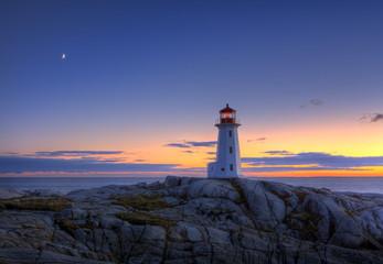 Sunset over lighthouse, Peggy's Cove, Nova Scotia, Canada
