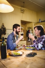 Couple having wine and breakfast