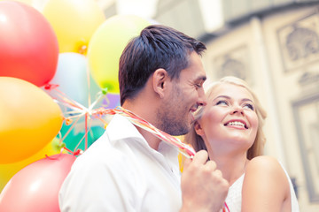 happy couple with colorful balloons