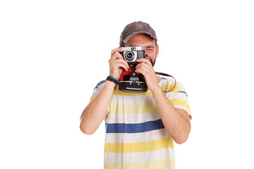 Mature man taking pictures with camera