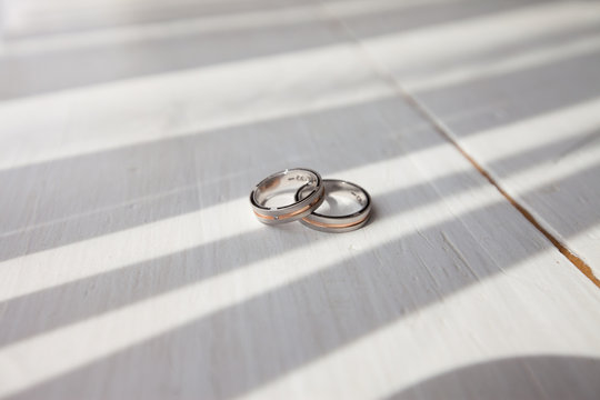 two wedding rings and beautiful shadow
