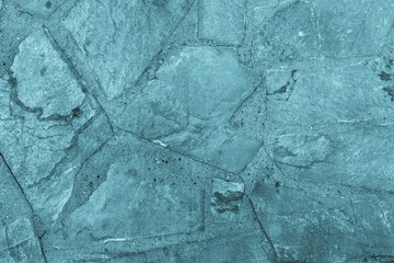 abstract textured background of a stone tile blue color