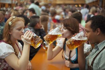 Friends enjoying Oktoberfest drinking beer
