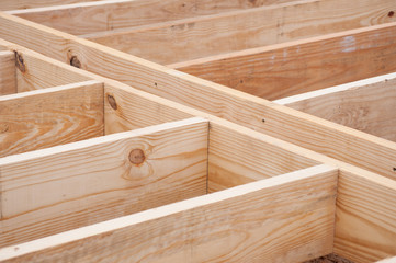 Floor joists made of lumber on construction site Wall mural