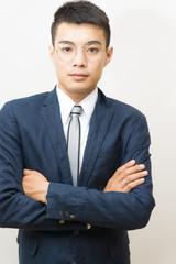 Portrait of asian businessman in black suit