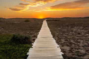 Wooden path to the sandy beach, San Giovanni di Sinis, Oristano, Sardinia, Italy