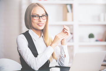 Cheerful european woman at workplace
