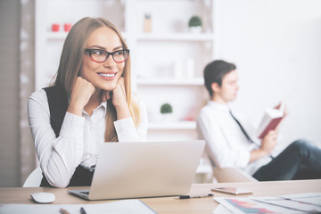 European woman daydreaming at workplace