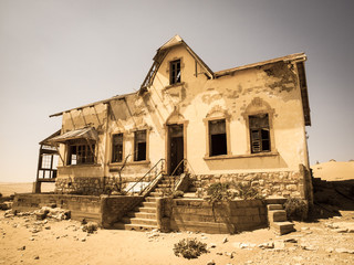 Ghost buildings of old diamond mining town Kolmanskop in Namibia