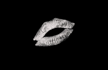 White kissing lips on a black background