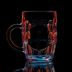 Silhouette of colorful beer glass with clipping path on black background