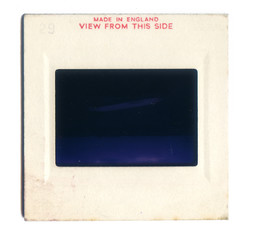 London, England, 06/06/2016 Vintage Slide film mount isolated on a white background