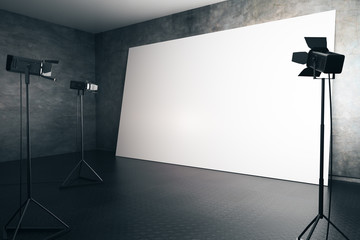 Blank white billboard with professional lighting