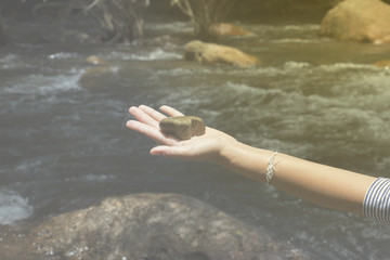 hand sign and  water,water is cold ,waterfall in natural,rock on hand