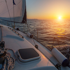 Wall Mural - Beautiful sunset on a boat in the open sea. Luxury sailing yacht.