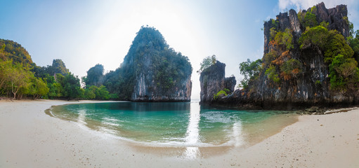 Wall Mural - Island with a sandy beach and huge rocky cliff in the Andaman sea