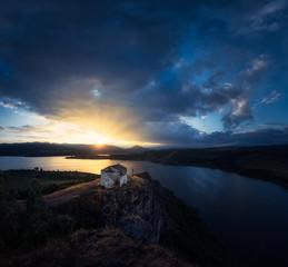 Sunset over shrine and lake