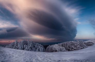 Snow cloud over landscape