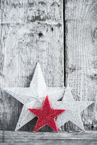 Silver And Red Stars On Rustic Wood Background Merry Christmas Card Winter Holiday Theme