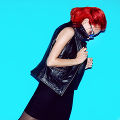 Sensual model with fashion hair. Red hair color. and trendy rock