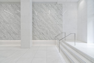 Stairs in tiled marble lobby