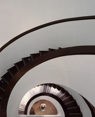 High angle view of mannequin at bottom of spiral staircase