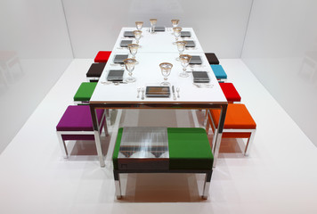 White dining table with colourful stools