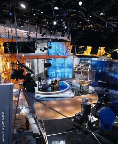Man rigging lighting equipment television studio & Man rigging lighting equipment television studio