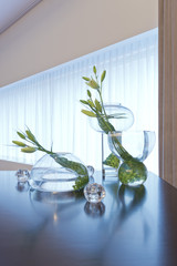 Glass vases with lilies